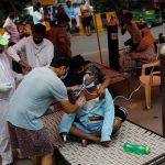 Opposition chief calls for lockdown as India's coronavirus cases cross 20 million